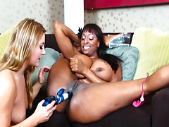 Horny lesbian ebon model with huge tits gets fucked with equipment