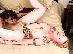 Tattooed lesbian babes take some time to play with tongue each other's pussy!