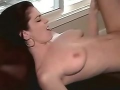 Horny lesbian with strapon fucking chick on chair