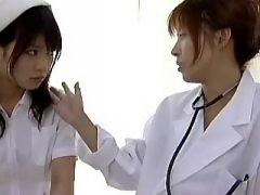 Asian lesbian licks nurse on table