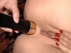 Depraved redhead lesbian gets dildo in asshole